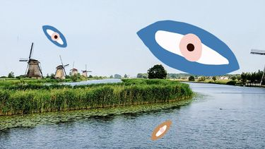 Nederlands landschap met windmolen