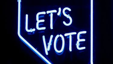 Let's vote in neon letters