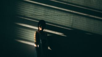 woman covered in shadows
