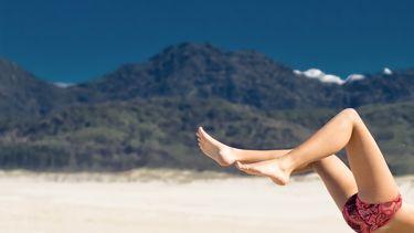 benen op strand hormonen