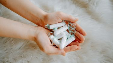 Person holding tampons