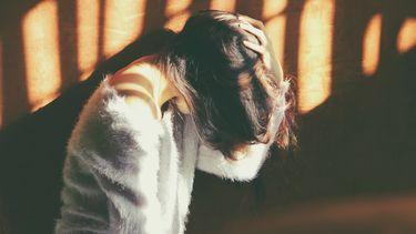 vrouw met migraine